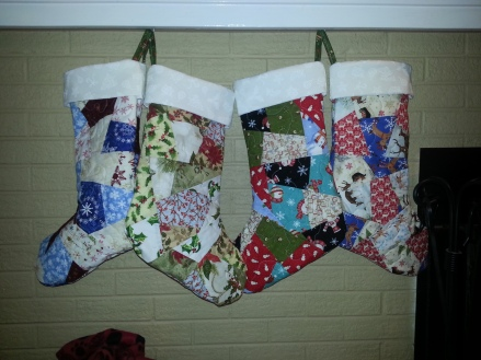 Crazy Quilt stockings- each has it's own theme- with a matching tree skirt incorporating all themes!