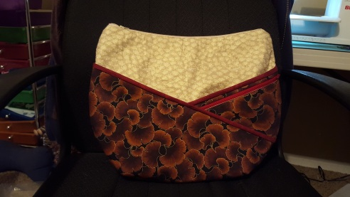 This purse was custom made for me- I added multiple zippers and other elements to suit me.